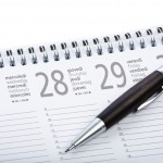black wooden pen on calendar agenda